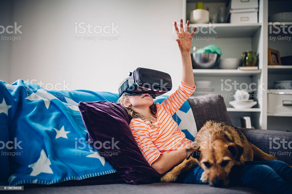 Little Girl Experiences Wearing a VR Headset stock photo
