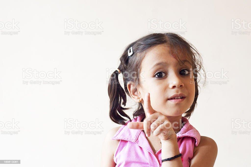 Little girl explaining stock photo