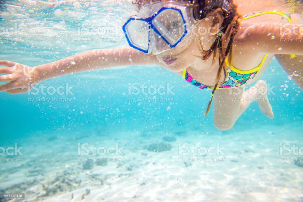 Little Girl Exploring The Sea Bed stock photo