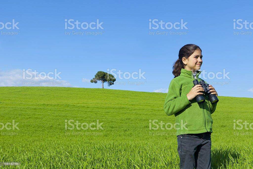 Little girl exploring with binoculars royalty-free stock photo