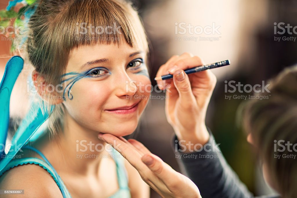 Little girl face painted stock photo