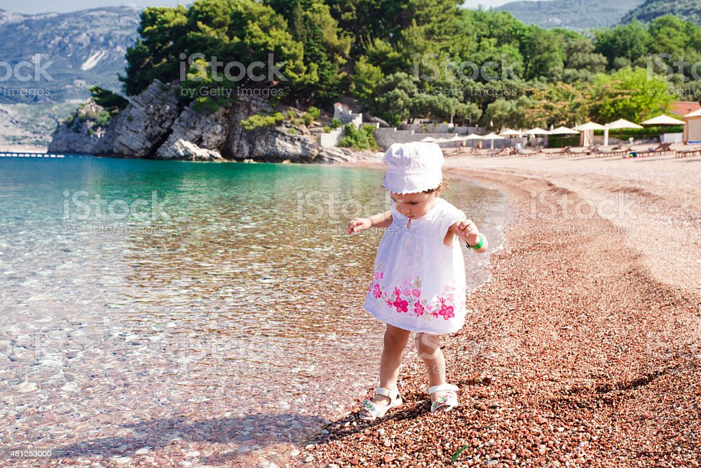 Little girl first time on the beach stock photo