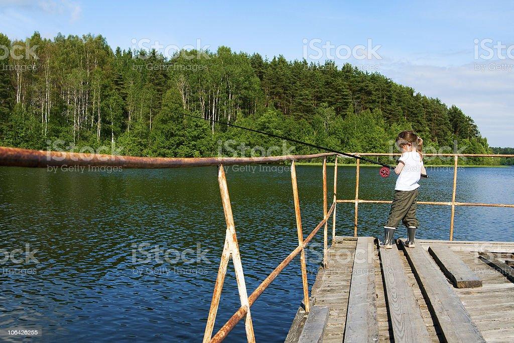 Little girl fishing. stock photo