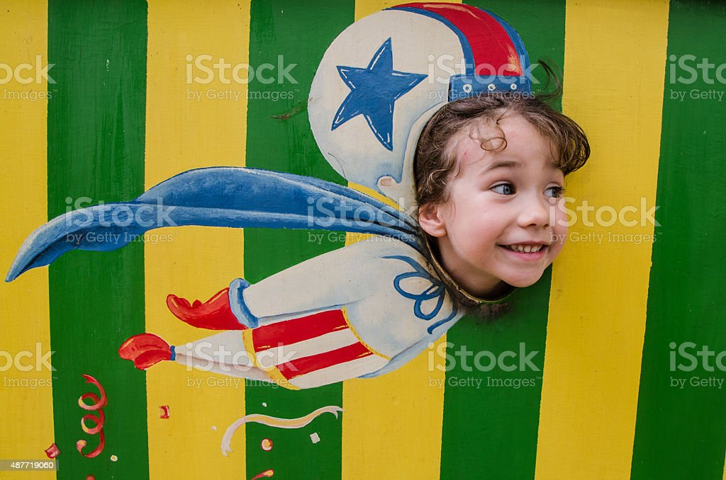 Little girl flying like a cannon ball out of cannon stock photo