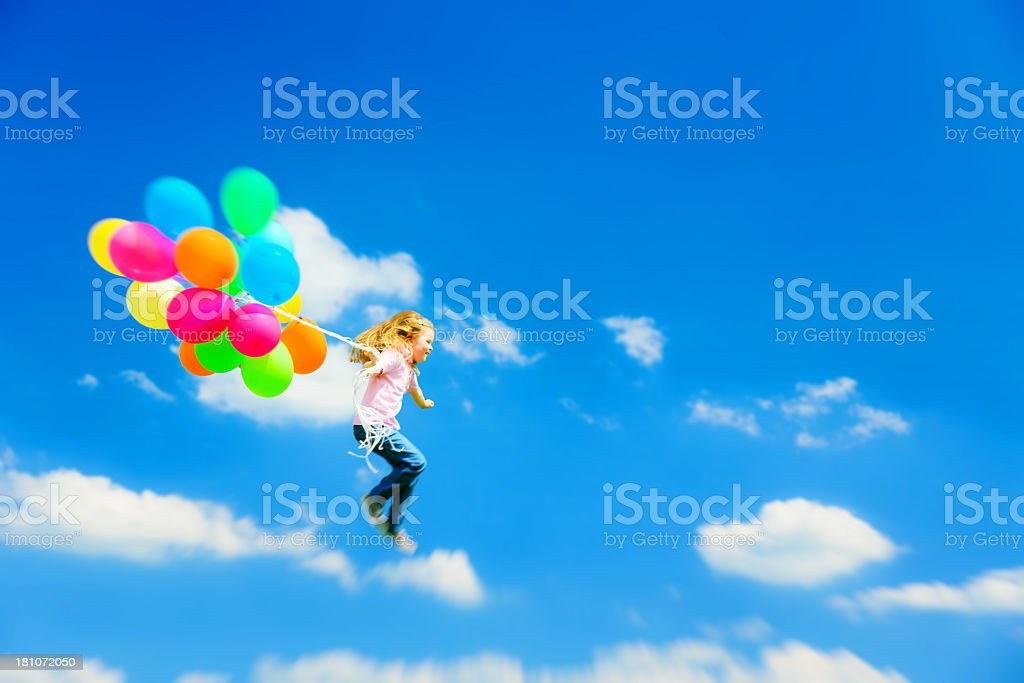little girl flying with colorful balloons royalty-free stock photo