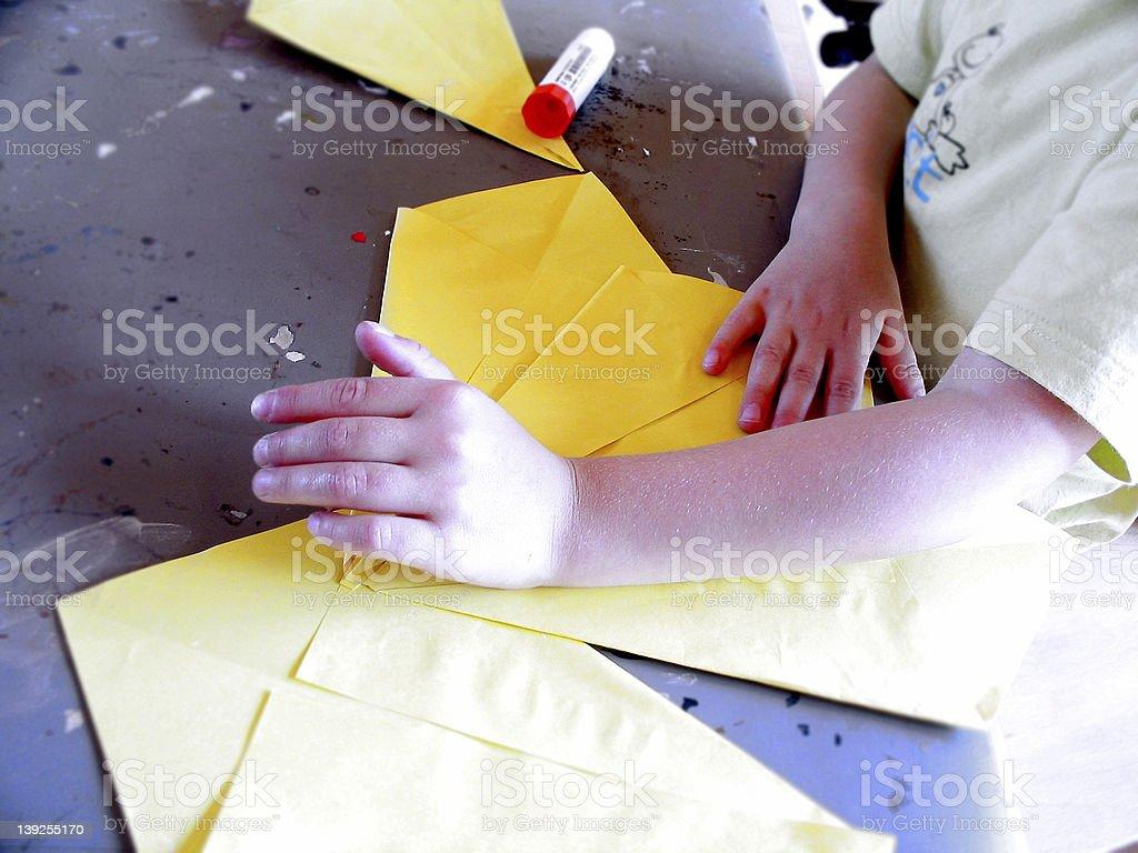 Little girl folding royalty-free stock photo