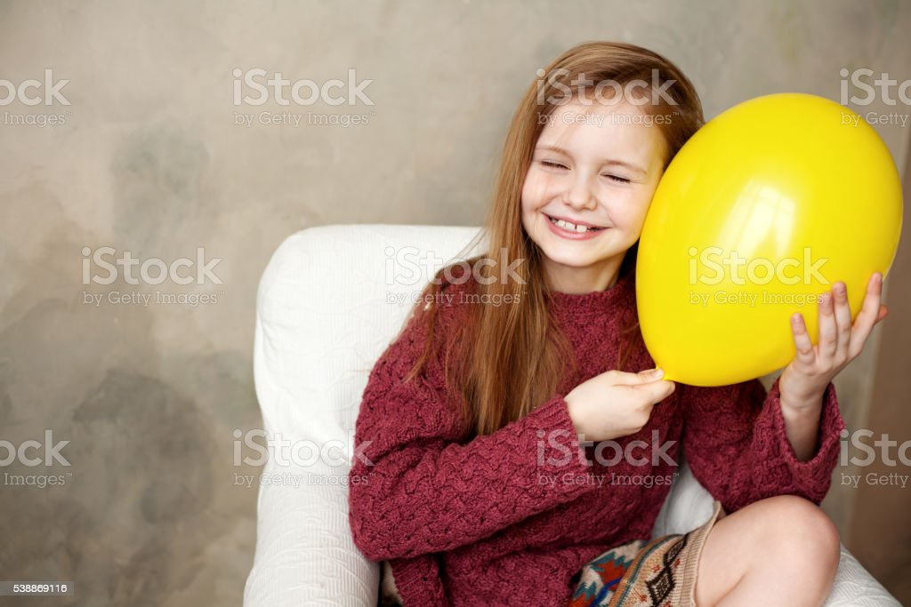 Little girl fooling in the studio stock photo