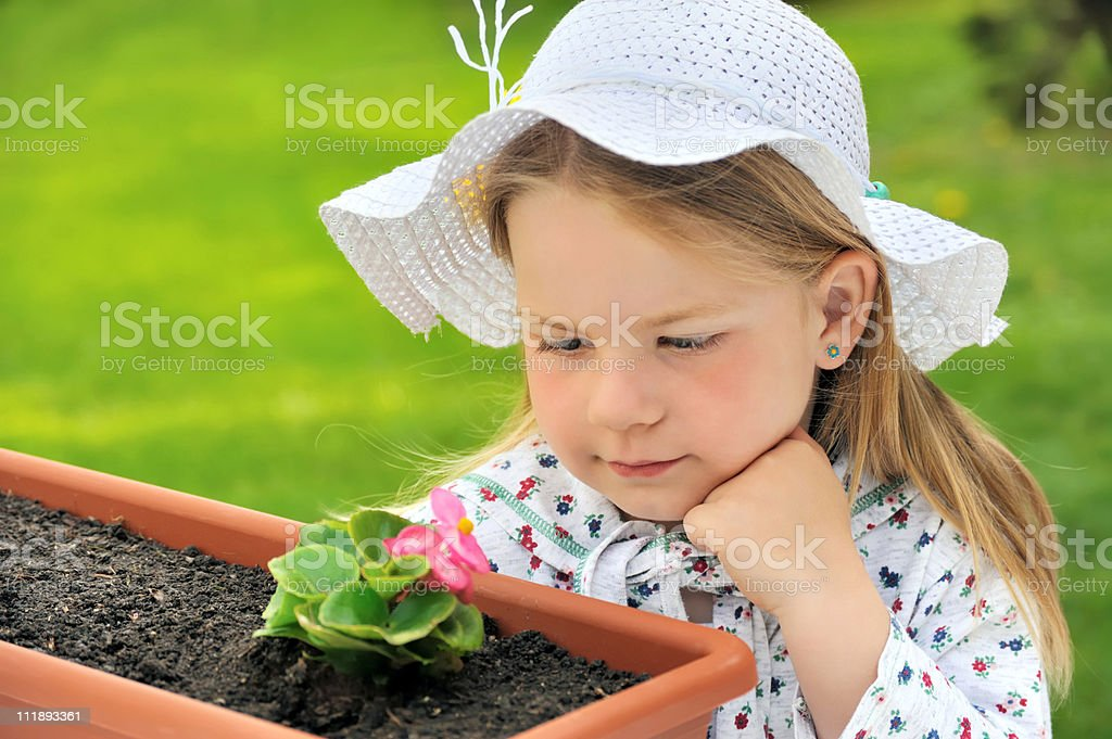 Little girl - gardening royalty-free stock photo