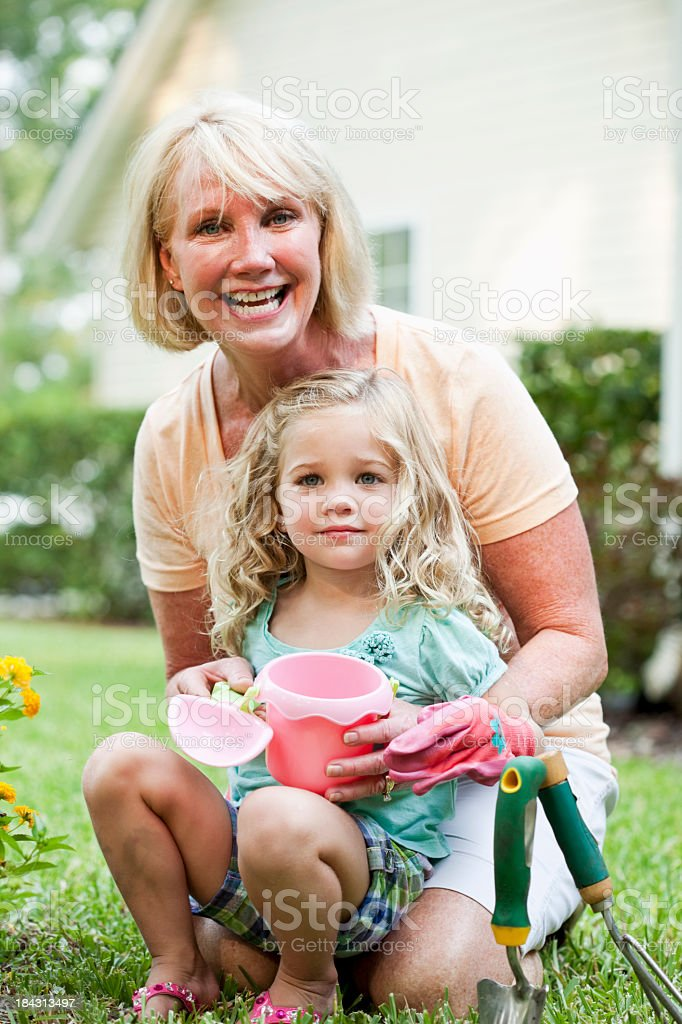Little girl gardening with grandmother stock photo