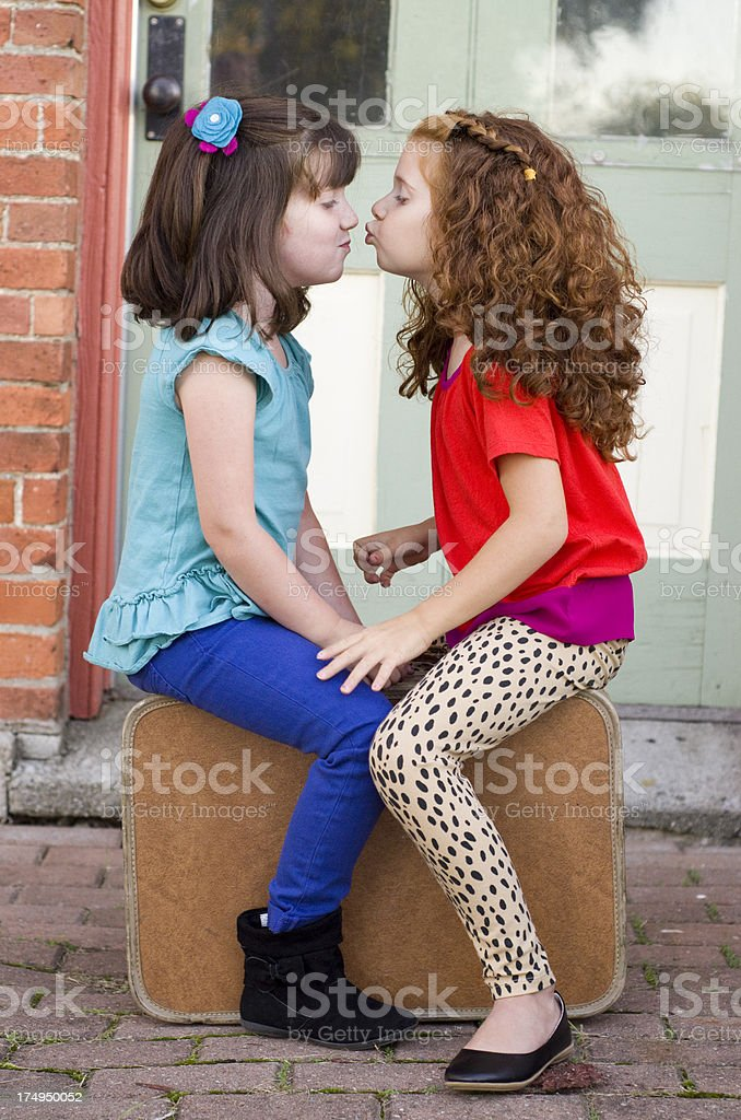 little girl gets ready to give a kiss royalty-free stock photo