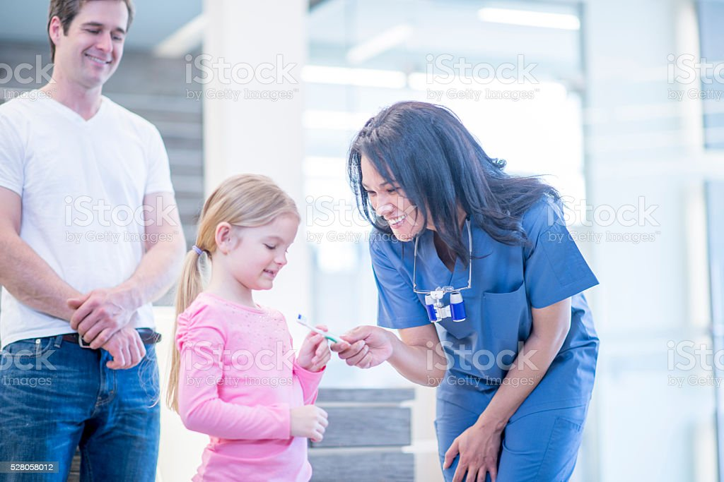 Little Girl Getting a New Toothbrush stock photo
