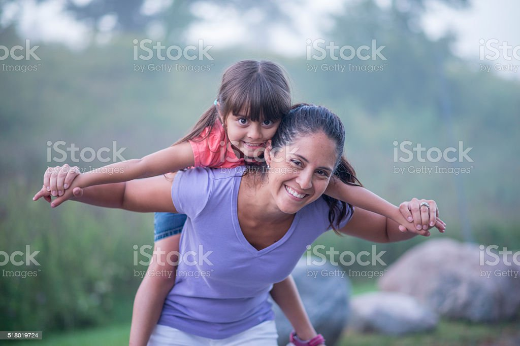 Little Girl Getting a Piggy Back Ride stock photo