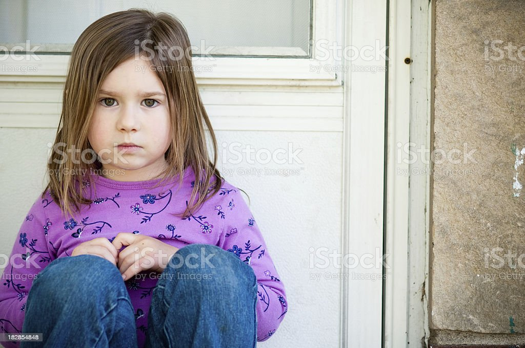 Little Girl Giving Look of Disapproval stock photo