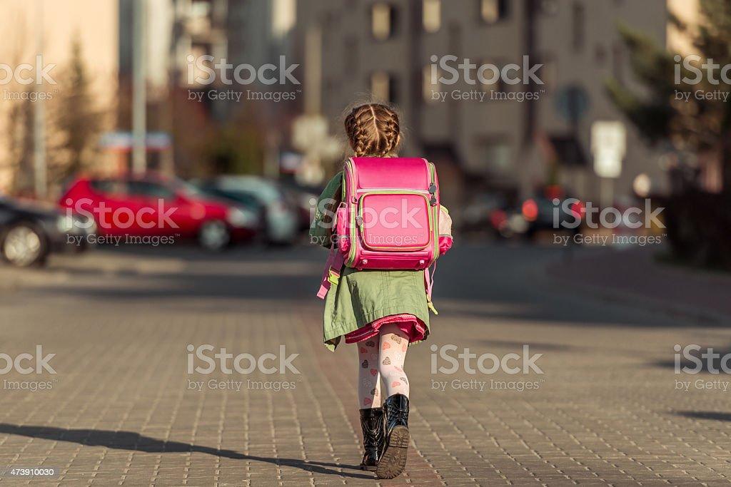 little  girl going to school stock photo