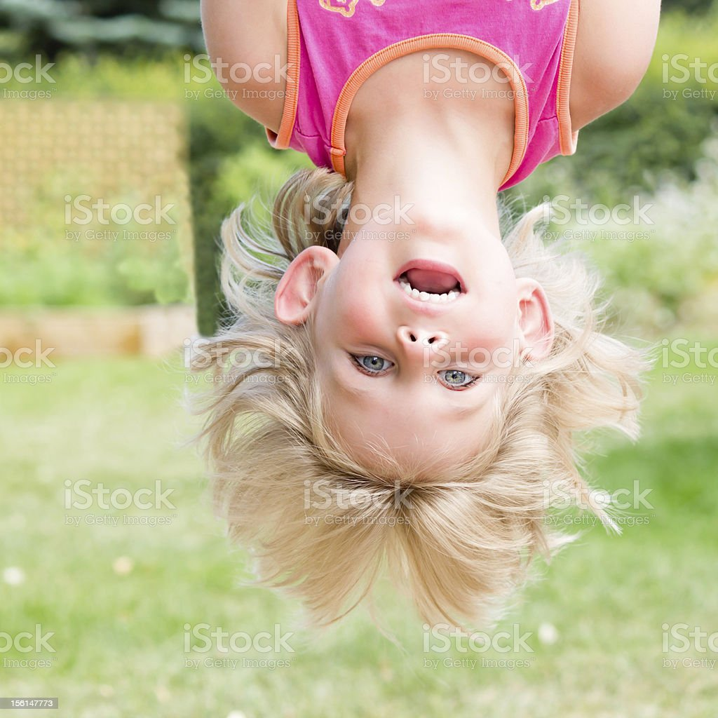 Little Girl Hanging Upsidedown royalty-free stock photo