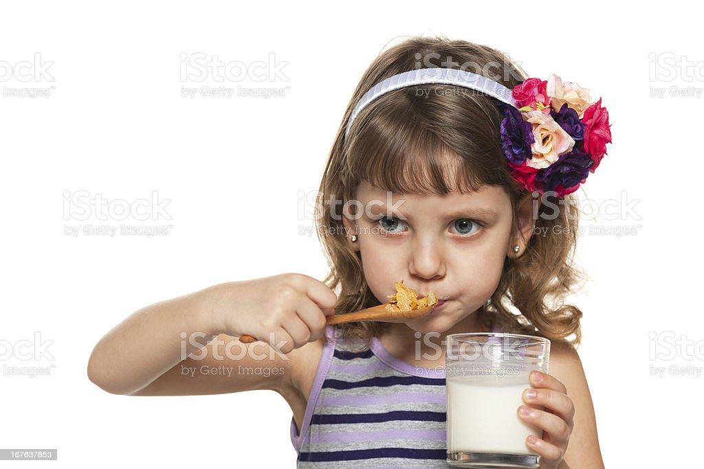 Little girl has her breakfast royalty-free stock photo