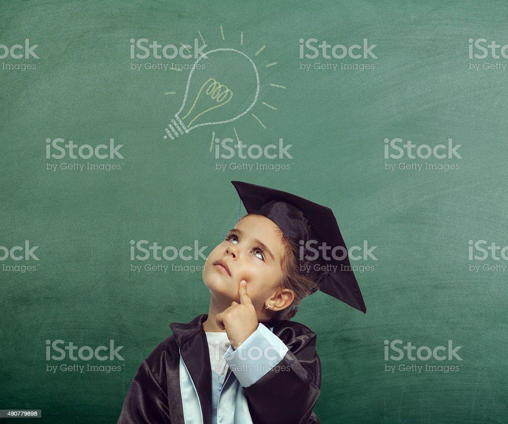 Little girl have a good idea! stock photo