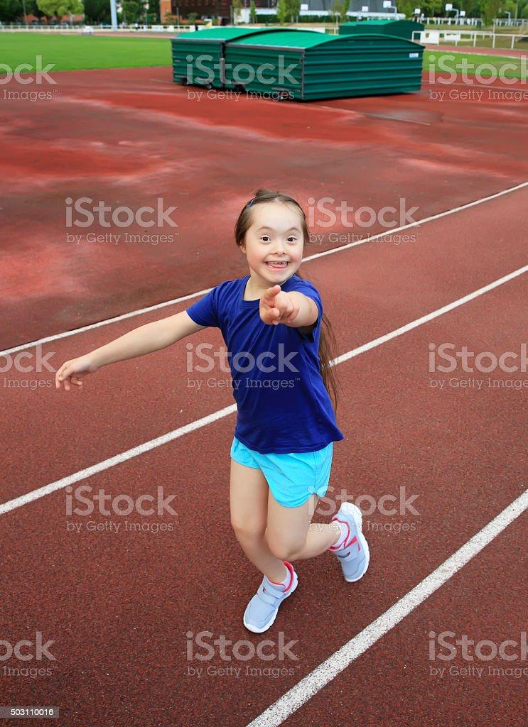 Little girl have fun on stadium stock photo