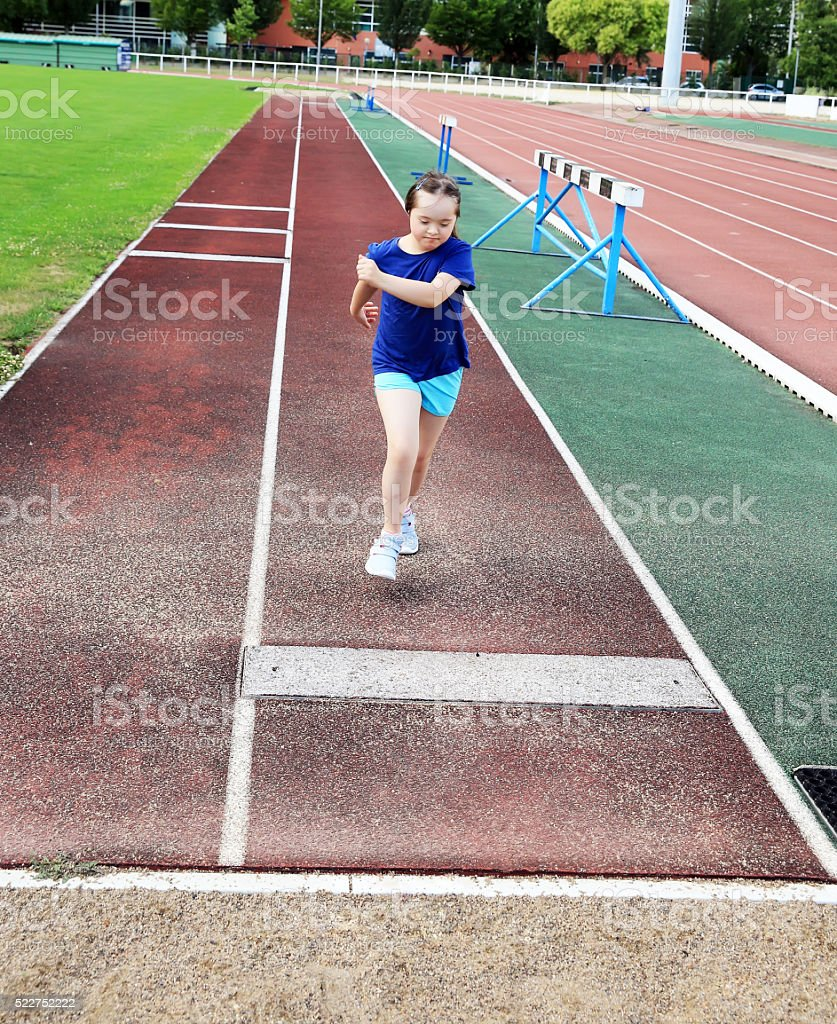 Little girl have fun on stadium stock photo