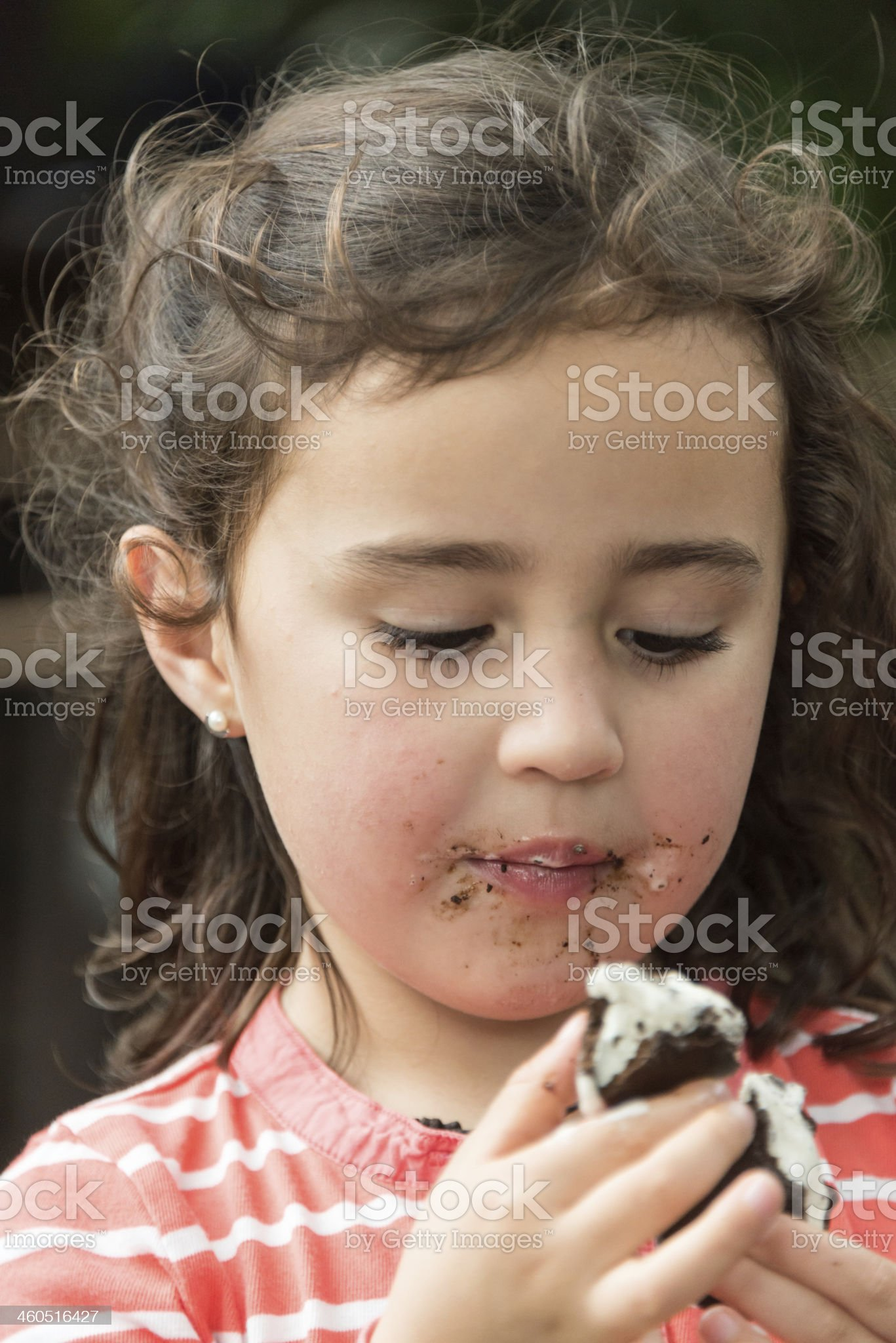 Little girl having an ice cream royalty-free stock photo