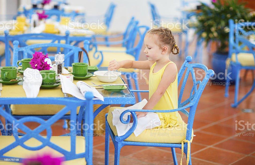Little girl having breakfast royalty-free stock photo