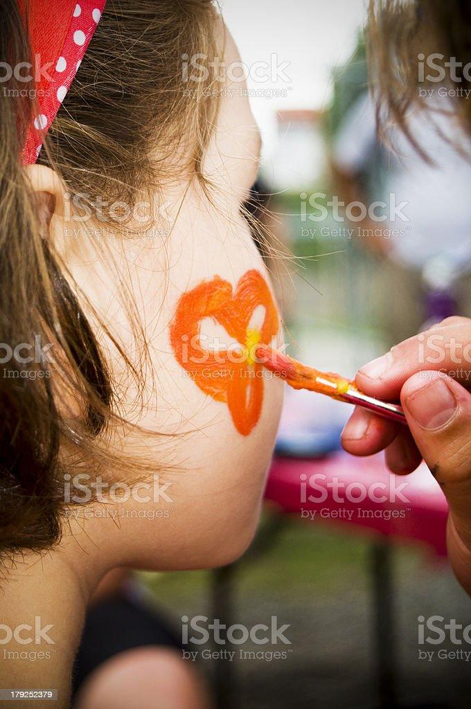 Little Girl Having Face Painted stock photo