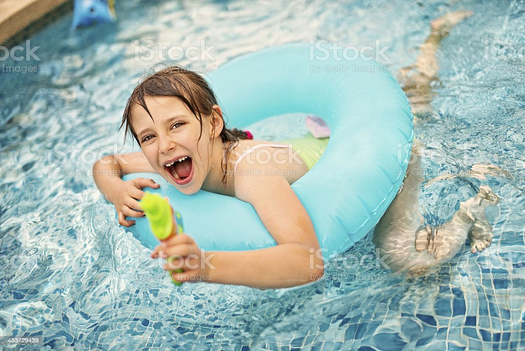 Little girl having fun in pool royalty-free stock photo