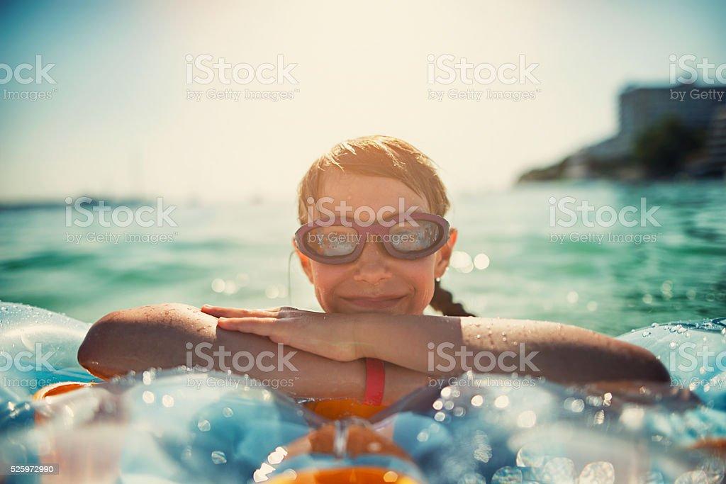 Little girl having fun in sea stock photo