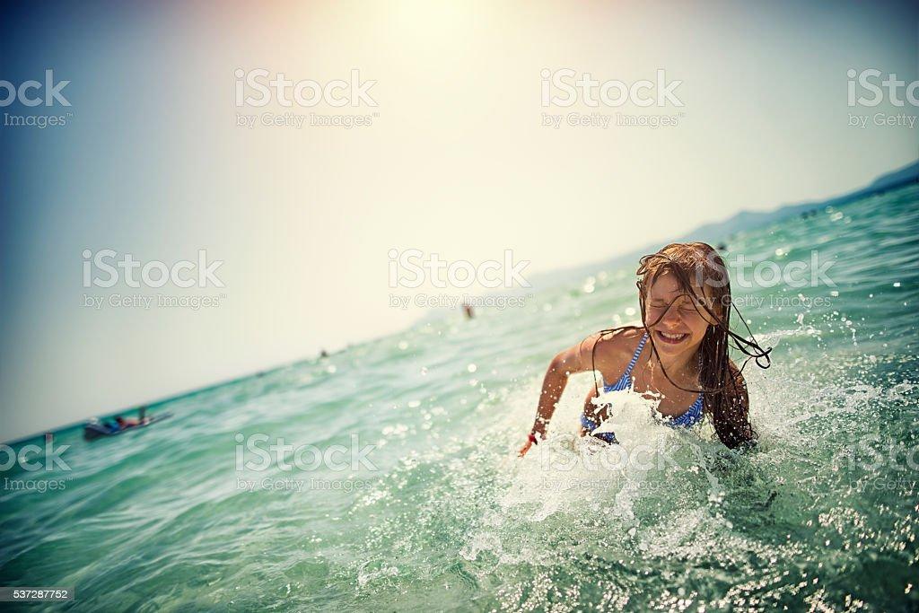 Little girl having fun in the sea stock photo