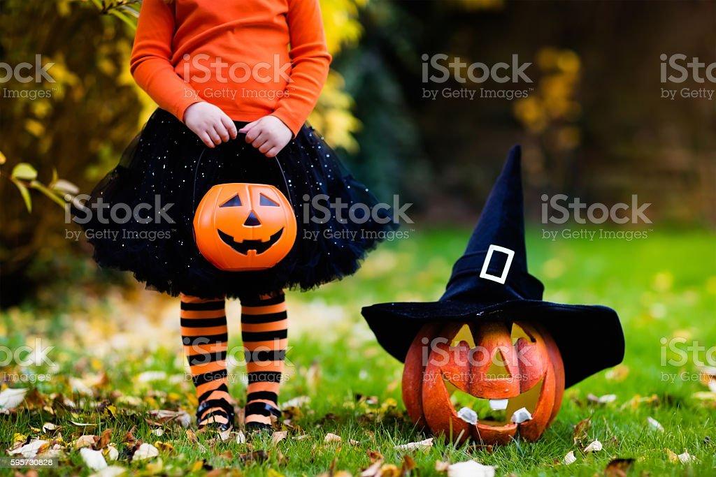 Little girl having fun on Halloween trick or treat stock photo