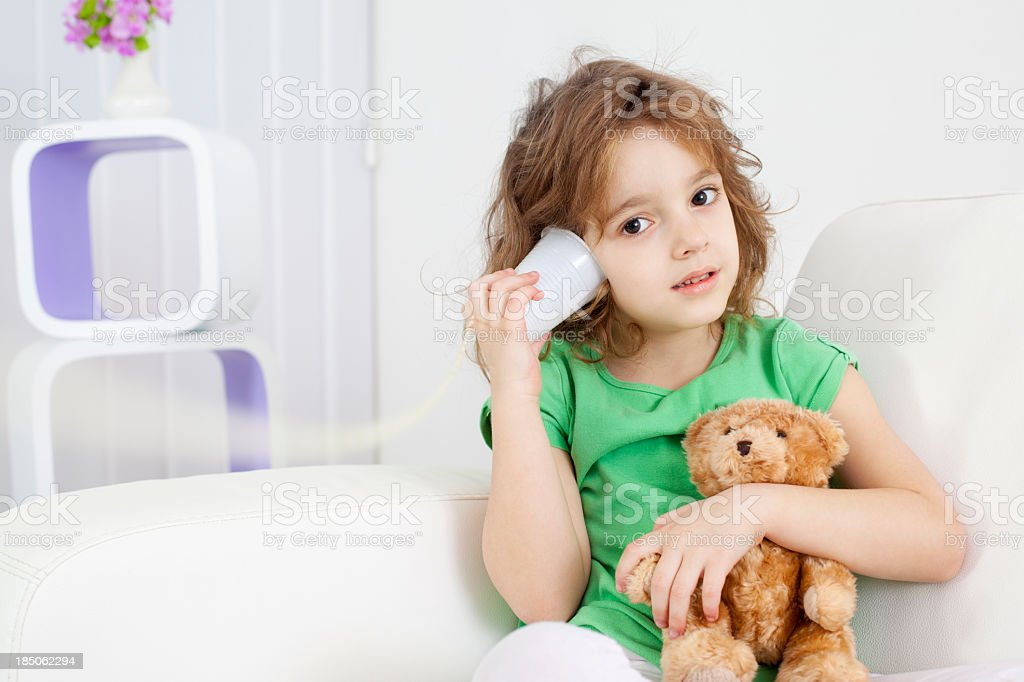 Little Girl Having Fun With String Phone royalty-free stock photo