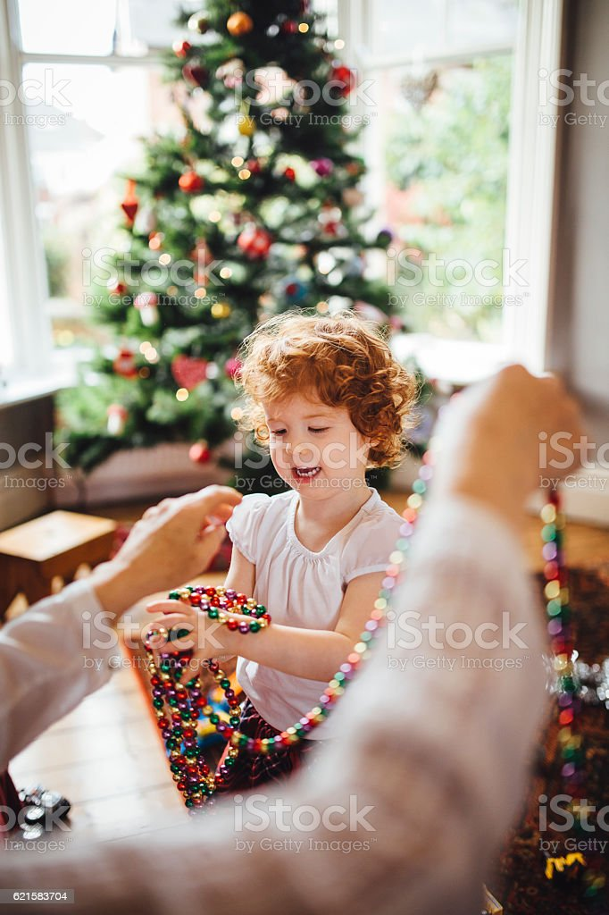 Little Girl Helping Grandma with the Christmas Decorations stock photo