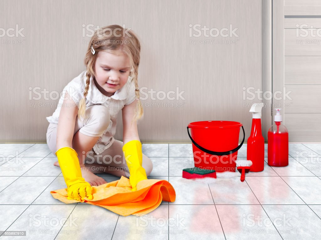 Little girl helps with the cleaning in the house. You wash the floors stock photo