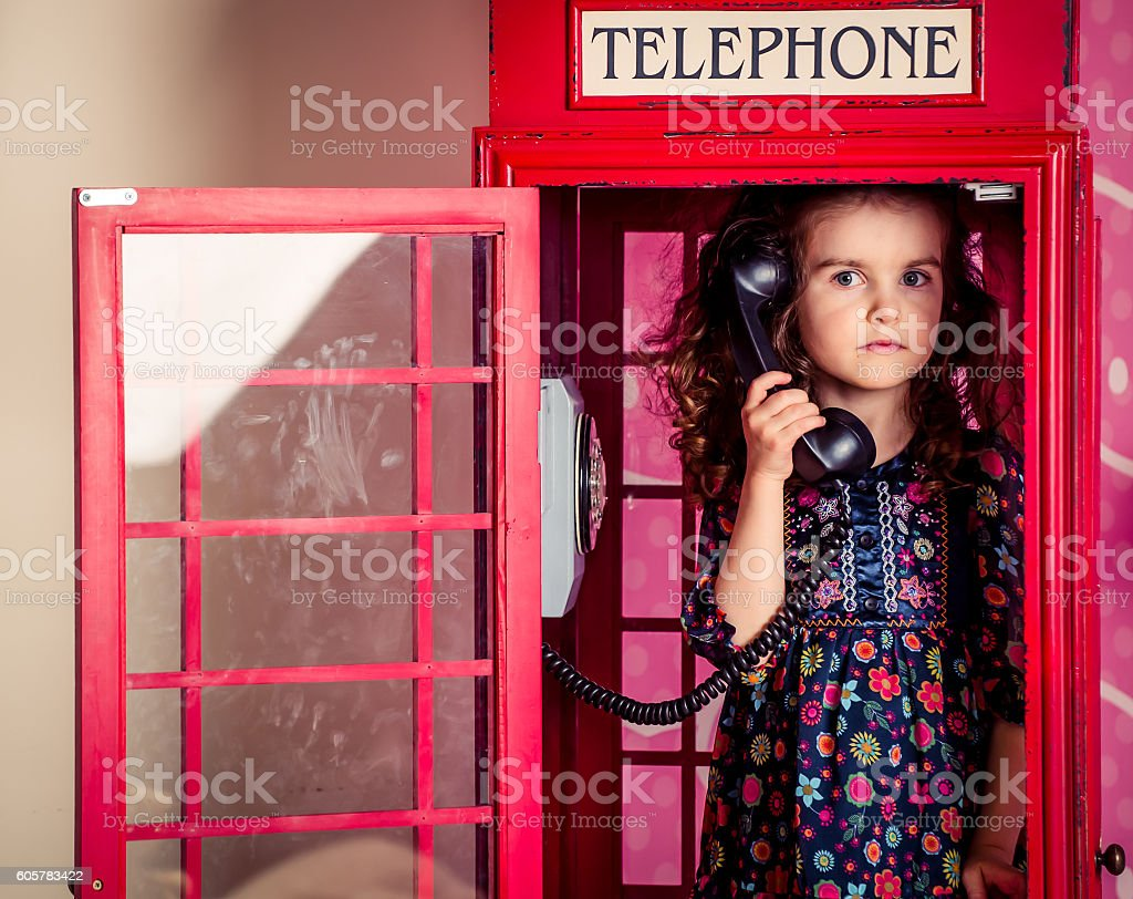little girl hides and plays stock photo