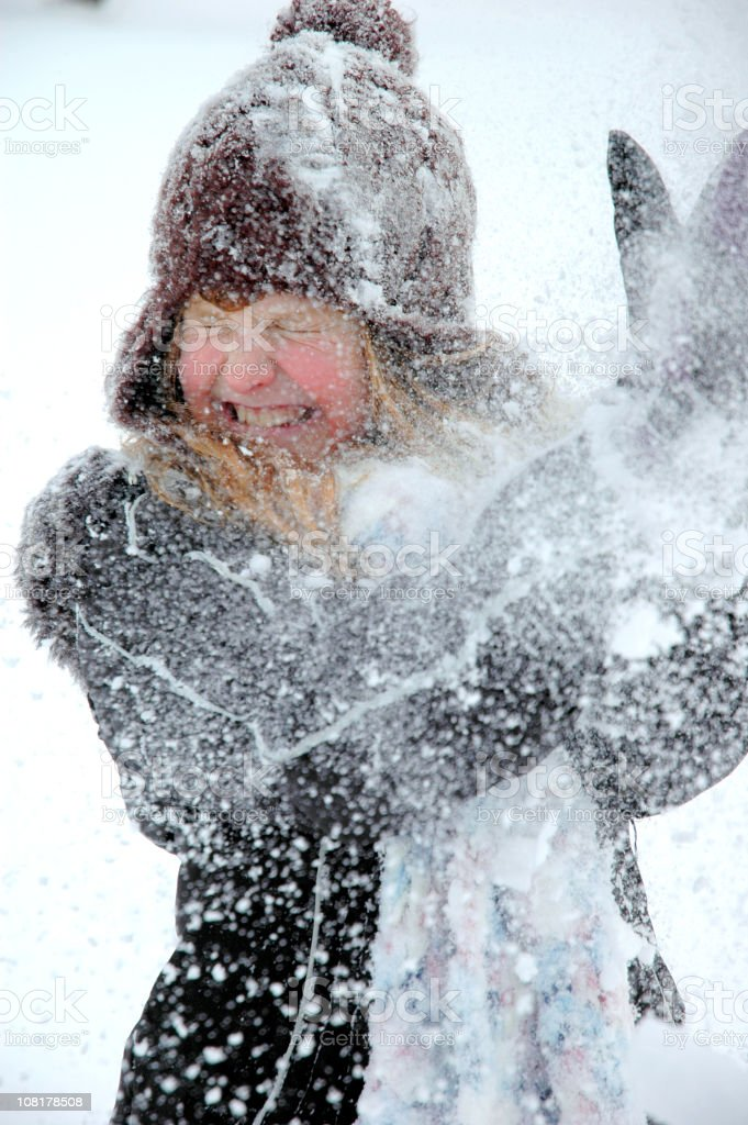 Little Girl Hit with Snowball stock photo