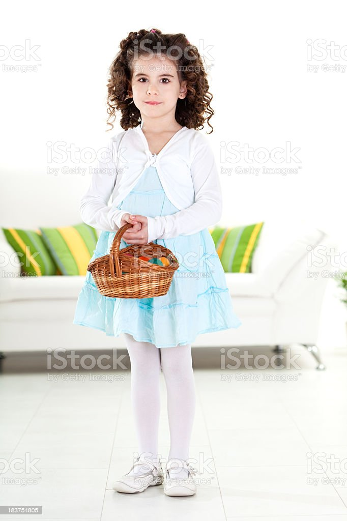 Little girl holding a basket with Easter eggs royalty-free stock photo