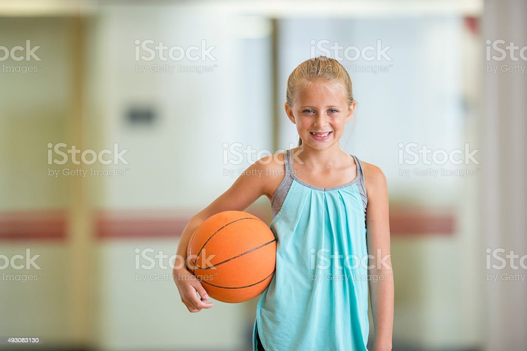 Little Girl Holding a Basketball stock photo