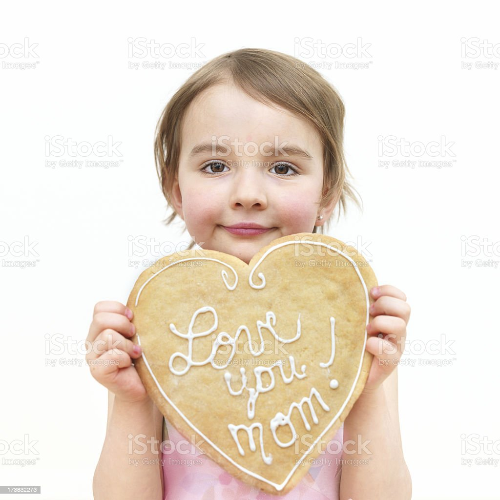 Little girl holding a cookie royalty-free stock photo