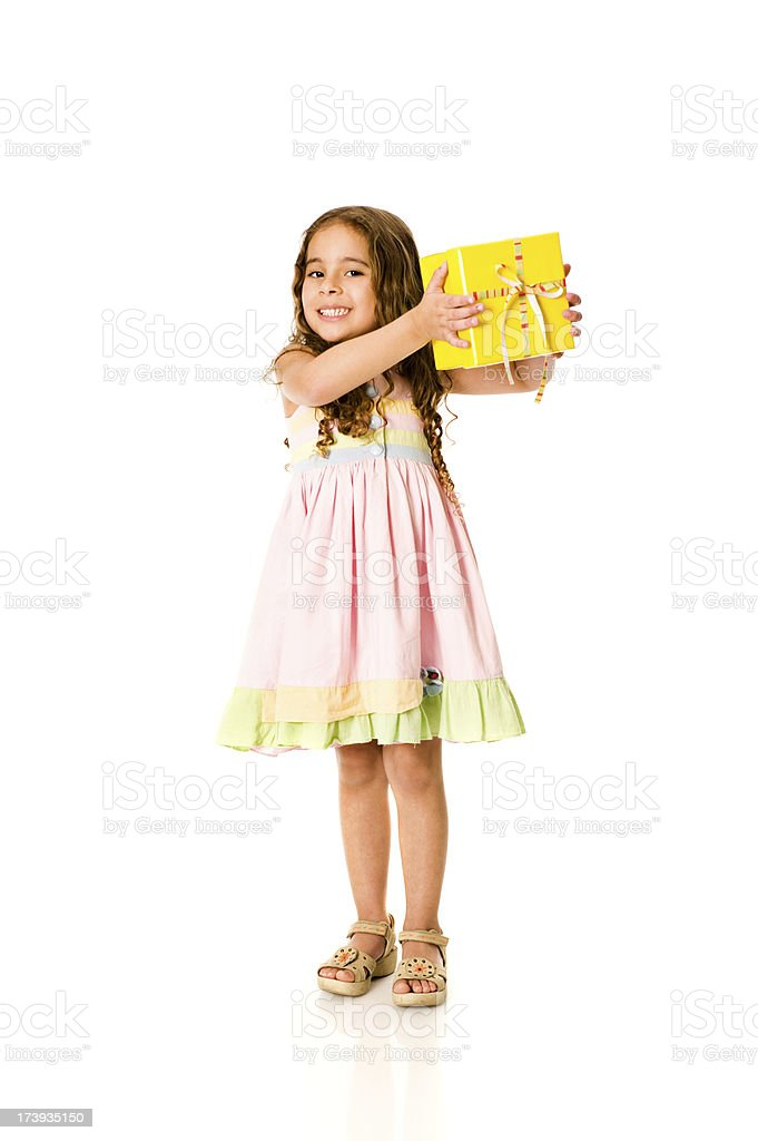 Little girl holding a gift royalty-free stock photo