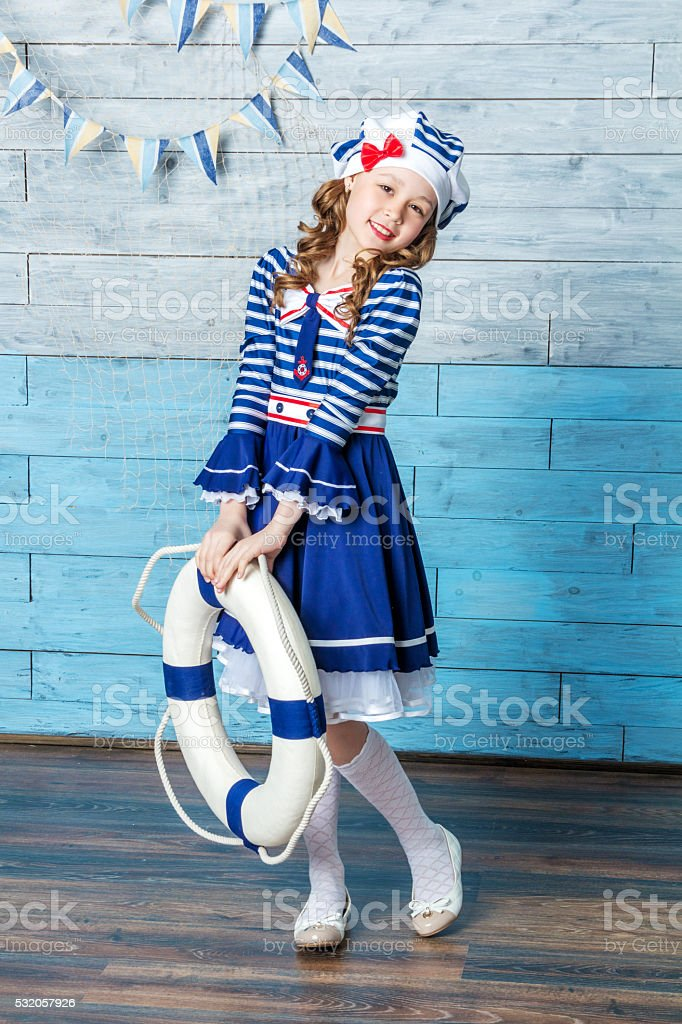 little girl holding a life preserver stock photo