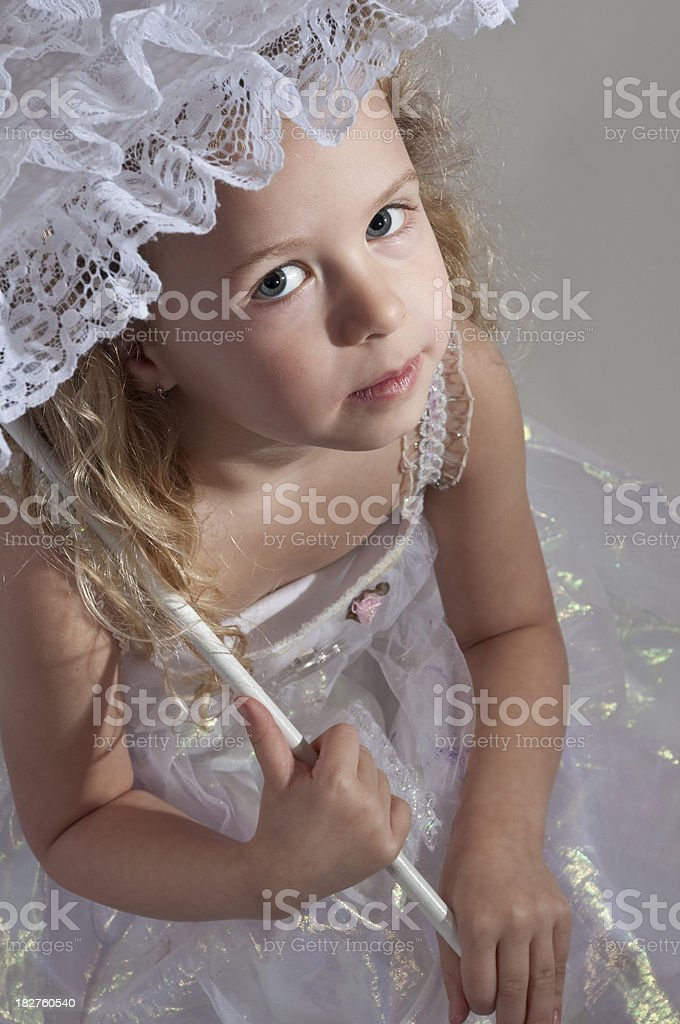 Little girl holding a parasol royalty-free stock photo