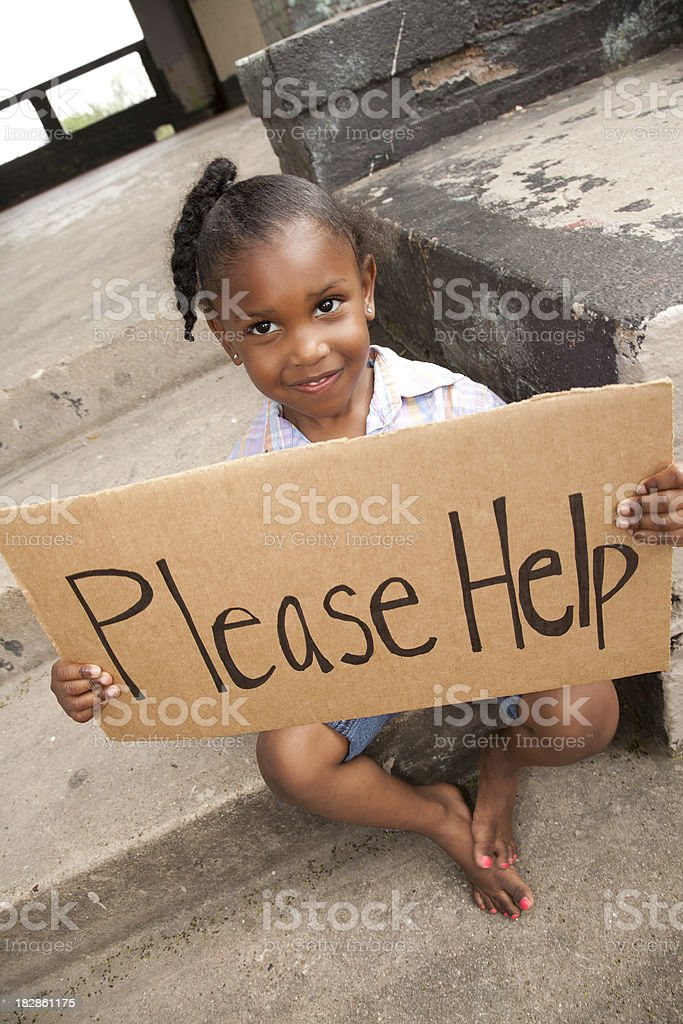 Little Girl Holding a Please Help Sign royalty-free stock photo
