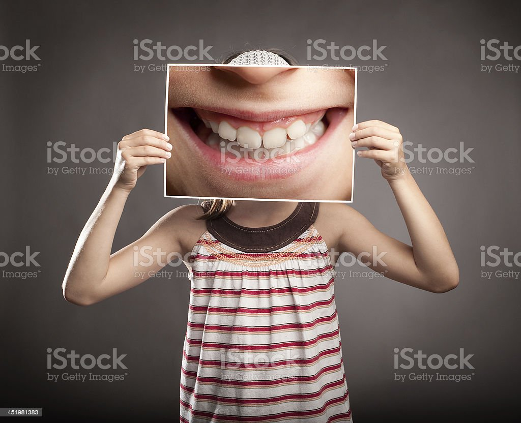 little girl holding a smile stock photo