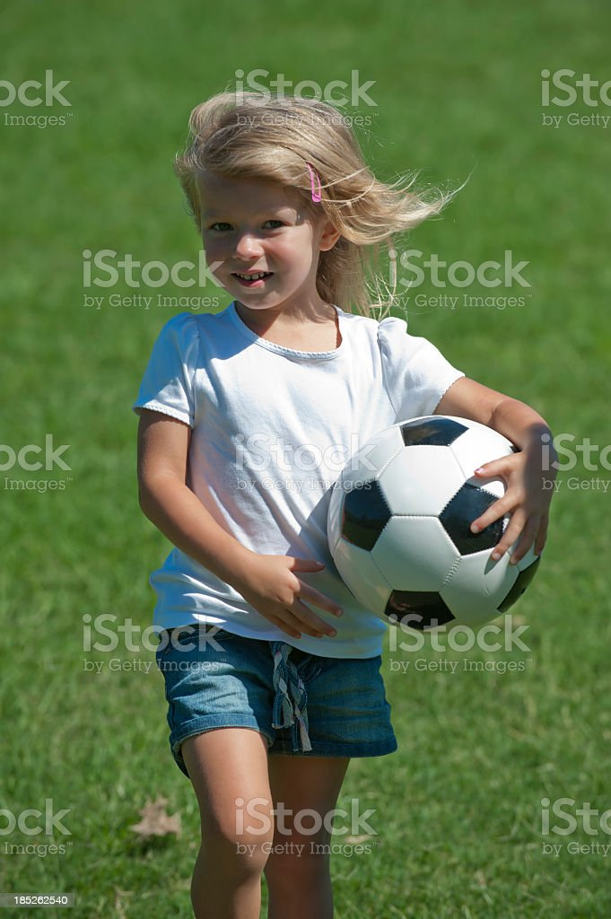 Little girl holding a soccer ball royalty-free stock photo