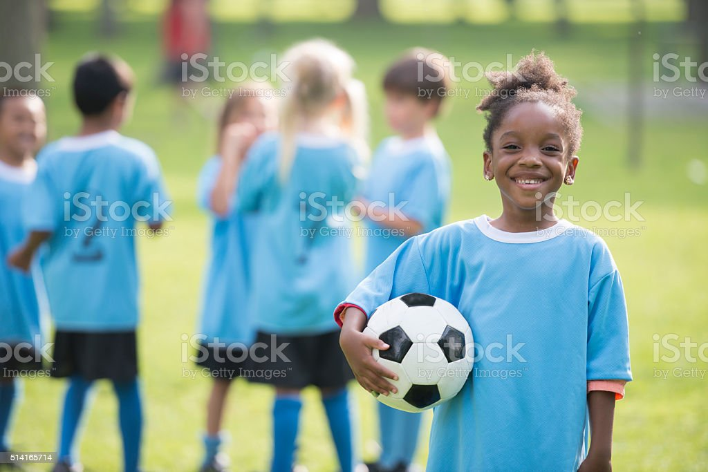 Little Girl Holding a Soccer Ball stock photo