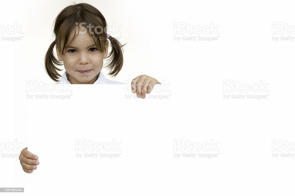 little girl holding a white banner royalty-free stock photo