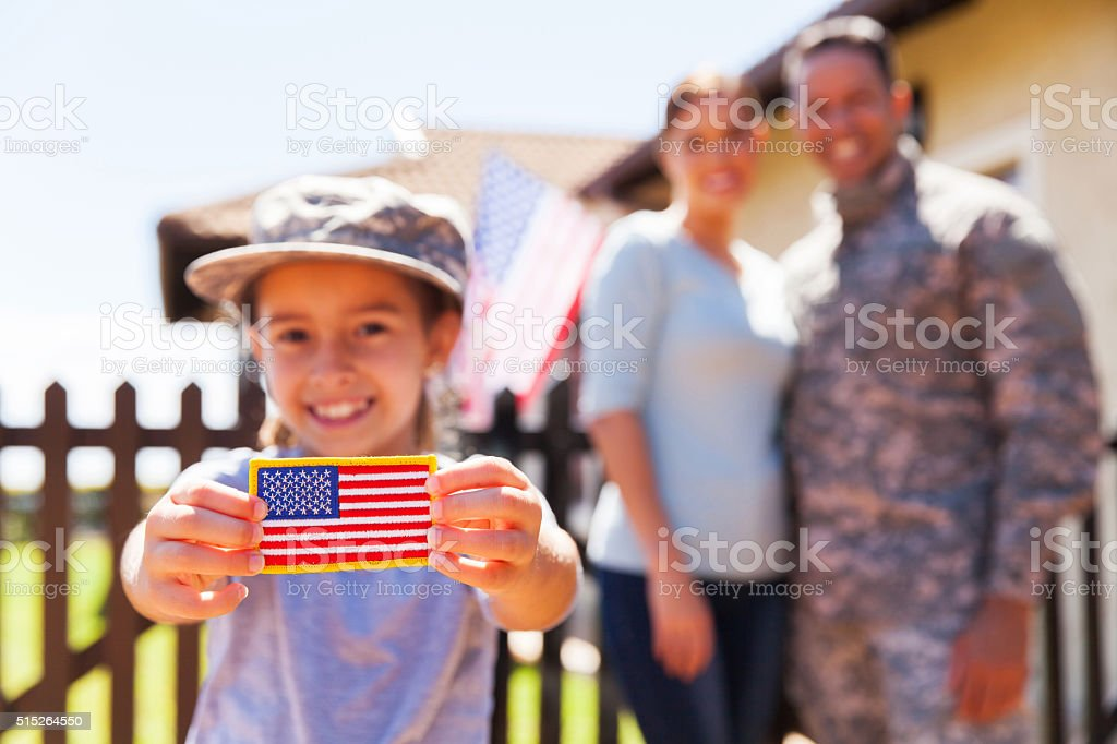 little girl holding american flag badge stock photo