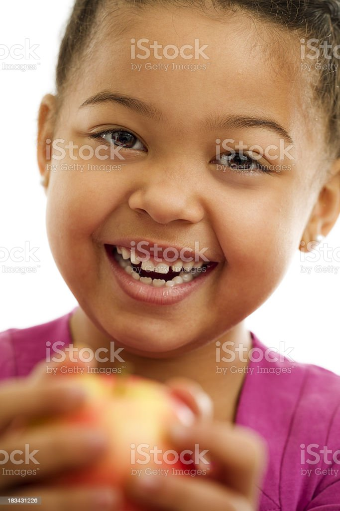 Little Girl Holding  an Apple stock photo