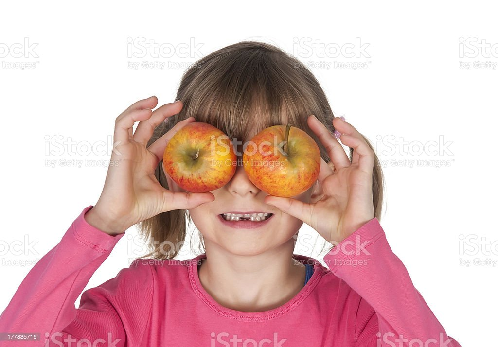 little girl holding apples as binocular stock photo