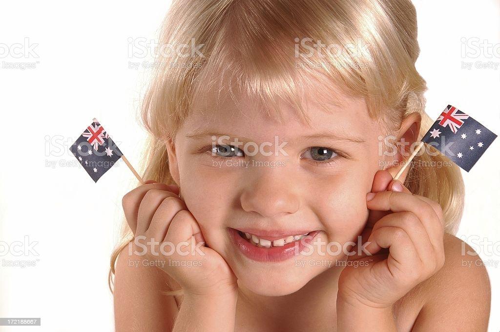 Little girl holding Australian Flags royalty-free stock photo